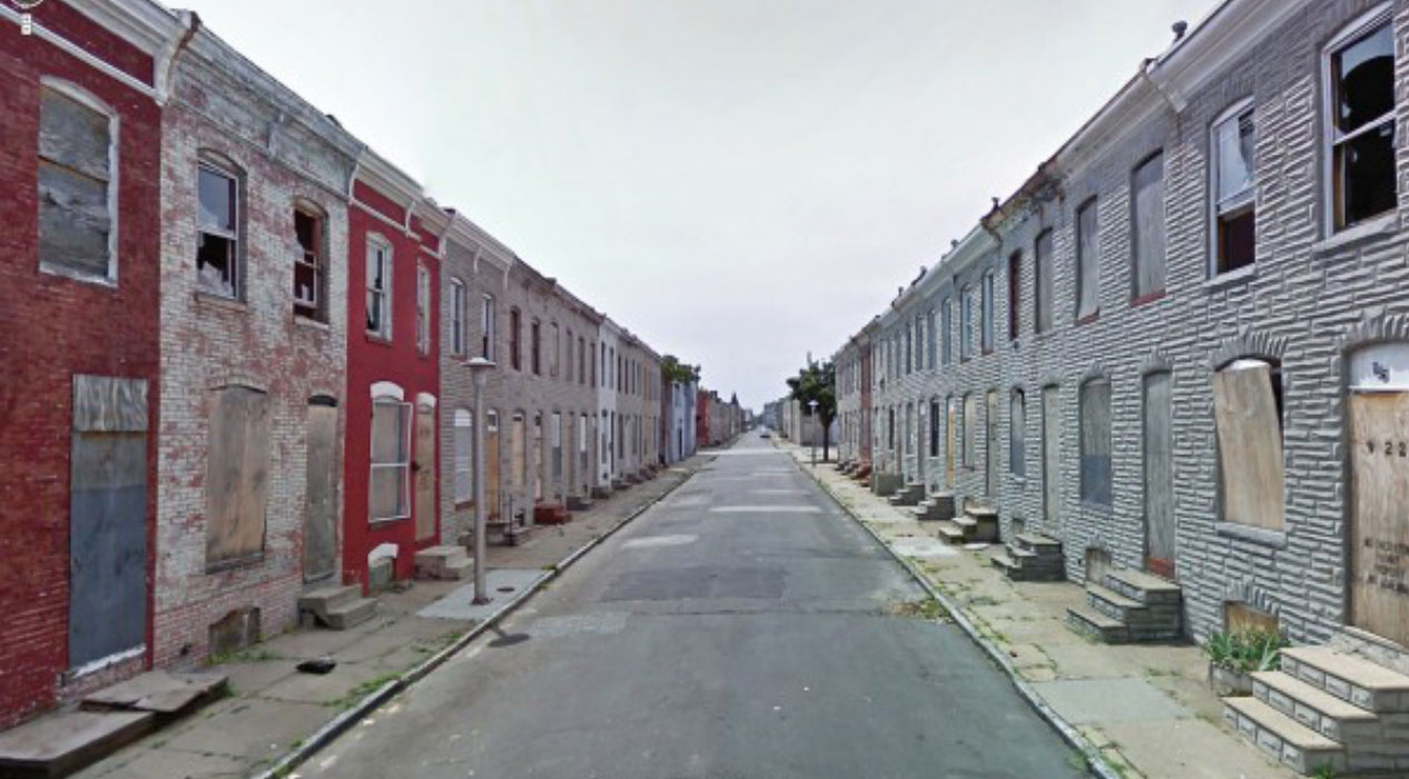 boarded up row homes in Baltimore