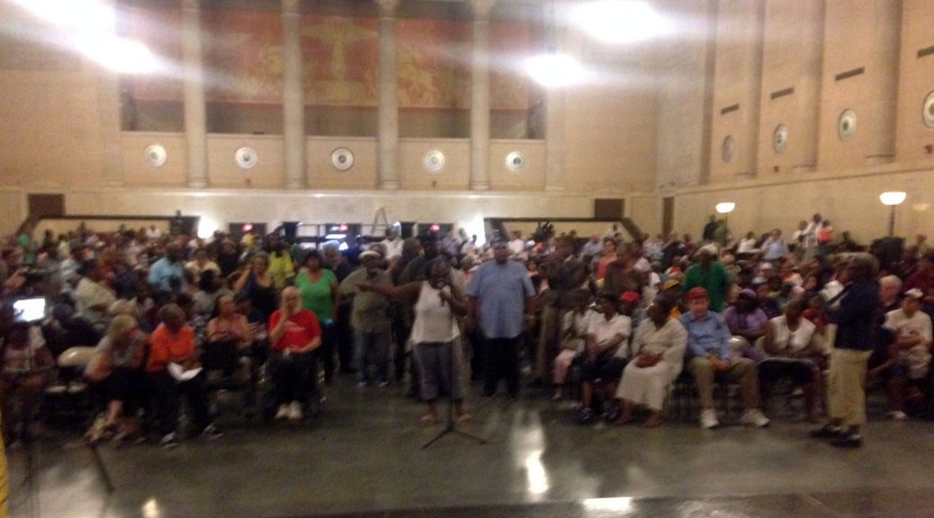 crowd of angry bus riders at MTA town hall meeting